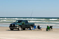 Pickup trucks on the beach Royalty Free Stock Images