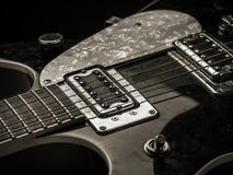Pickups and strings of old electric guitar Stock Photos