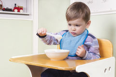 Picky eater. Toddler looking at his food with no apetite Royalty Free Stock Photos