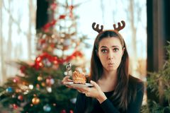 Picky Girl Hating The Cake at Christmas Dinner Party. Unhappy girl find the dessert disgusting at Xmas office celebration stock photo