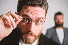 Picky smart inspector. Man handsome bearded guy wear eyeglasses. Eye health and sight. Optics and vision concept. Smart royalty free stock photos