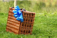 Picnic. A brown picnic basket with a big blue bow on it. Meant to be presented as a gift Stock Photos