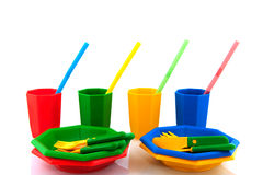 Picnic. Colorful  plasticpicnic set with drinking straws isolated over white Royalty Free Stock Photography