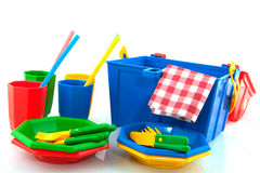 Picnic. Colorful  plasticpicnic set with drinking straws isolated over white Royalty Free Stock Images