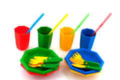 Picnic. Colorful  plasticpicnic set with drinking straws isolated over white Royalty Free Stock Image