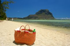 Picnic. On the beach, focus on basket Stock Image