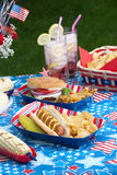 Picnic on 4th of July. Hot dogs, corn and burgers on 4th of July picnic in patriotic theme Royalty Free Stock Image