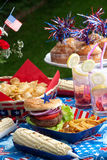 Picnic on 4th of July. Cornbread, corn and burgers on 4th of July picnic in patriotic theme stock images