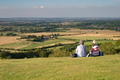 Picnic. Two ladies having a picnic on a hill Royalty Free Stock Photos