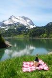 Picnic in Alpine meadow Stock Photos