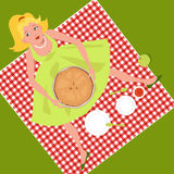 Picnic with an apple pie. Cute cartoon girl sitting on a checked red table cloth on a grass, holding an apple pie Stock Image