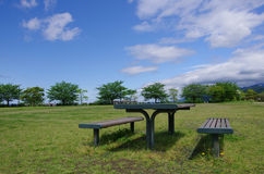 Picnic area. A table and two benches at a picnic area Royalty Free Stock Images