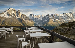 Picnic area in the French Alps. Picnic tables and mountains of Mont Blan in the background, in the French Alps Stock Photos