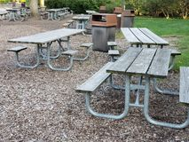 Picnic tables in a park. Picnic area in a park with dedicated picnics tables and waste buckets Stock Photos
