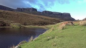 Picnic area at the road to Flodigarry next to Lochan nan Dunan with the Quiraing in the background . Isle of Skye. Scotland stock video footage