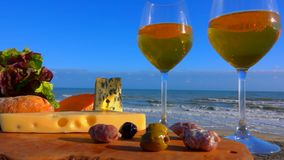 Picnic on the Atlantic coast with cheeses and wine stock video footage
