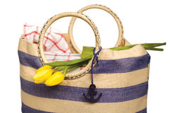 Picnic bag with flowers Stock Photos
