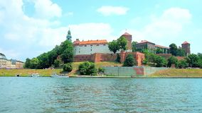 Picnic on the bank of Vistula river, Krakow, Poland. Enjoy the picnic on the bank of Vistula river, opening the view on medieval Wawel Castle with preserved stock video footage