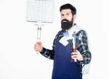 Picnic and barbecue. Cooking meat in park. Masculine hobby. Bearded hipster wear apron for barbecue. Roasting and stock photos