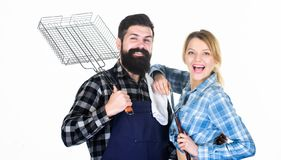 Picnic and barbecue. Family getting ready for barbecue. Backyard barbecue party. Cooking together. Essential barbecue stock images