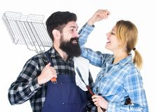Picnic barbecue. food cooking. Family weekend. Couple in love hold kitchen utensils. Man bearded hipster and girl. Preparation and culinary. Tools for roasting stock image