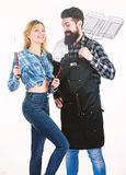 Picnic and barbecue. Man bearded hipster and girl ready for barbecue party. Culinary concept. Family weekend. Couple in royalty free stock photography