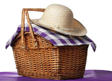 Picnic basket. With straw hat, white background Stock Photography