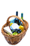 Picnic basket. With cheese, grapes and wine isolated on a white background Royalty Free Stock Photos