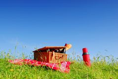 Picnic basket 2. Picnic basket with wine and bread on grass with blue sky background Royalty Free Stock Image