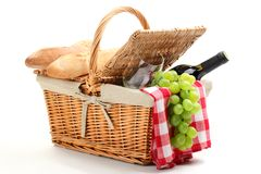 Picnic basket. Filled with fruit,bread and red wine Stock Photography
