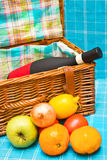 Picnic basket. Open picnic basket with wine, fruits and vegetables Stock Image