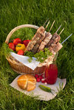 Picnic basket. Basket with lots food at the green grass Royalty Free Stock Images