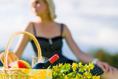 Picnic basket. And woman out of the focus on background, horizon format Royalty Free Stock Images