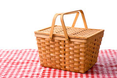 Picnic Basket. A picnic basket on a white background with a gingham tablecloth Stock Image