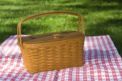 Picnic Basket. Not sharpened. Wooden woven picnic basket with was handmade in Ohio, sitting on red and white checked table cloth stock photo