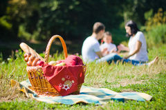 Picnic Basket. With apples and bread. Family disfocused Royalty Free Stock Images