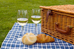 Picnic basket, baguette and glass of wine Stock Photo