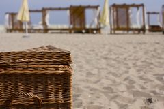 Picnic basket on the beach Stock Images