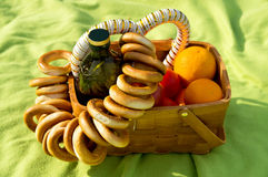 Picnic basket on the bedspread Stock Images