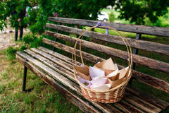 Picnic basket on a bench Stock Image