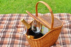 Picnic Basket On The Blanket Close-up. Lawn On The Background Royalty Free Stock Photography