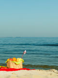 Picnic basket on blanket near sea. Relaxation during summertime concept. Picnic basket with fruit on red blanket near sea Stock Photos