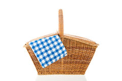 Picnic basket. With blue checked napkin isolated over white background Stock Image