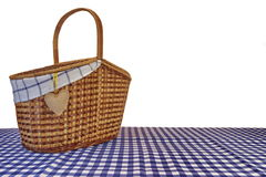 Picnic Basket On The Blue Checkered Tablecloth Isolated On White Stock Photography