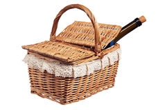 Picnic basket with a bottle of wine, isolated. On white Stock Photography