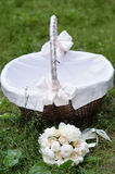 Picnic basket and bouquet Stock Images