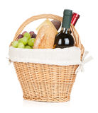 Picnic basket with bread, cheese, grape and wine bottles Stock Image