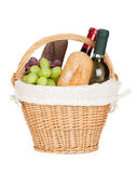 Picnic basket with bread, cheese, grape and wine bottles Royalty Free Stock Image