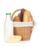 Picnic basket with bread, cheese and milk bottle Royalty Free Stock Photography