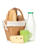 Picnic basket with bread, cheese and milk bottle Stock Photos